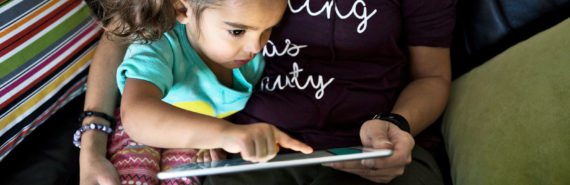 mom and preschooler read on tablet - read to kids