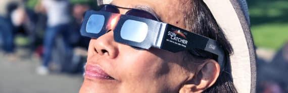 woman observing solar eclipse 2017
