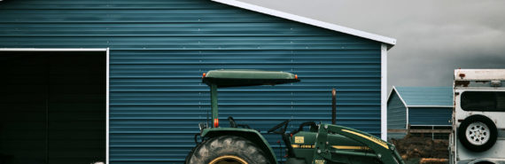 tractor and barn, impending rain - rain follows the plow