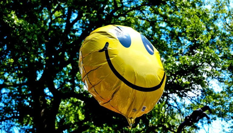 smiley face balloon (well-being concept)