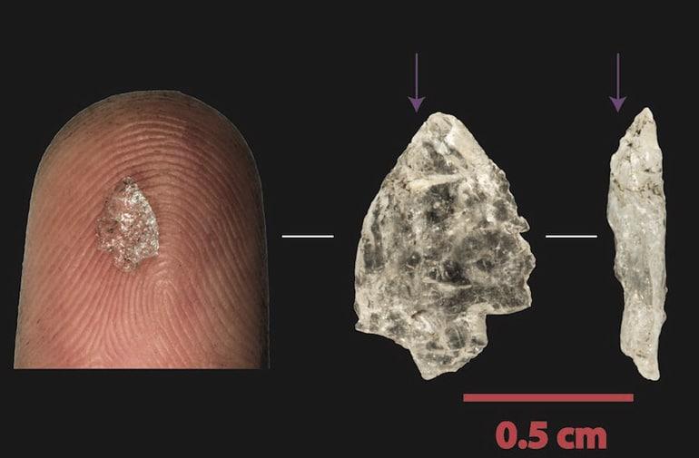 tiny crystal quartz flake on finger