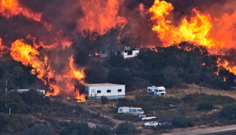 Flames sweep through a rural community at the Blue Cut Fire on August 17, 2016 near Wrightwood, California.