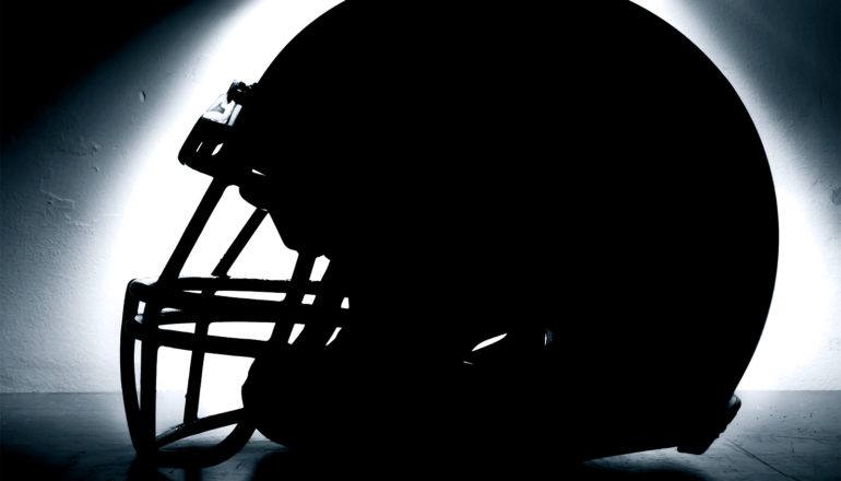 football helmet silhouette (concussions symptoms concept)