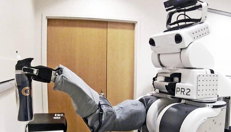 robot picks up cup