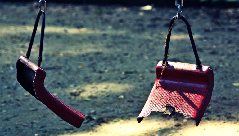 broken swing at playground