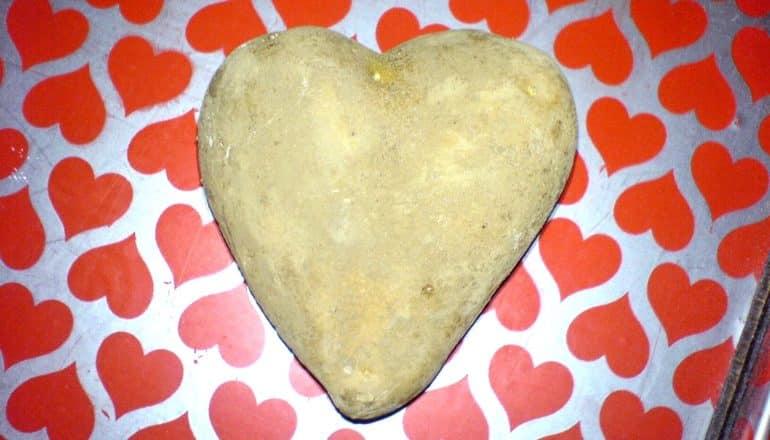 starch - heart-shaped potato on red heart pattern
