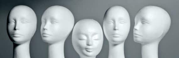 mannequin heads on a shelf