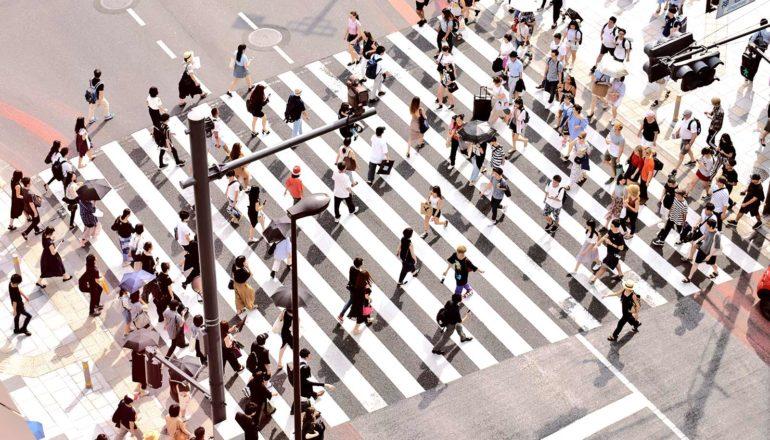 Aerial shot of crosswalk (population concept)