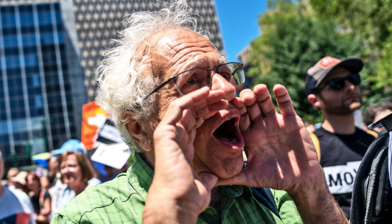 man yelling at protest (debates concept)