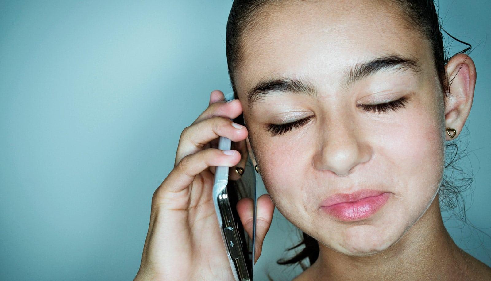 Teen girl phone emotion 1600