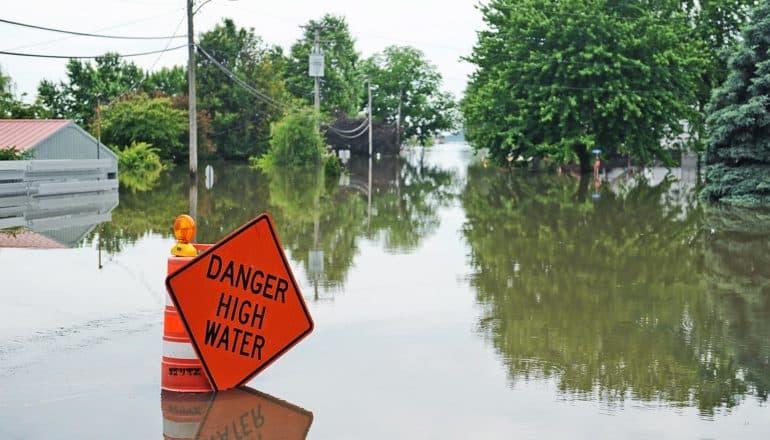 """danger high water"" sign in flood"