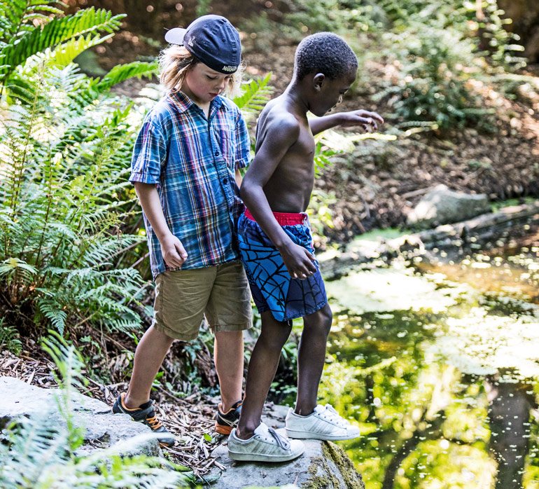 Two children explore the grounds within Washington Park Arboretum