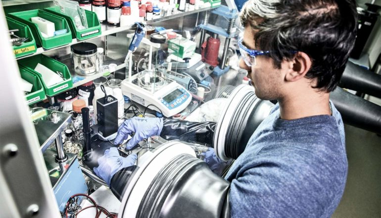 Dhruv Prakash works in a laboratory focused on battery research (solid-state batteries concept)