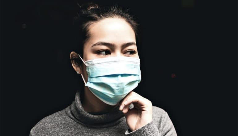 woman wearing medical mask (epidemic concept)