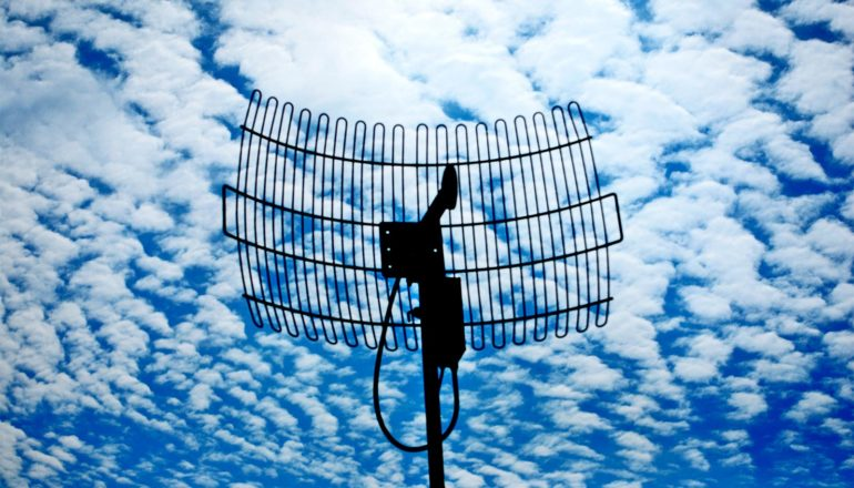 The image shows an antenna against the sky.
