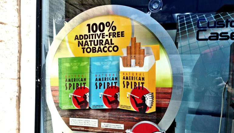 The image shows an ad for Natural American Spirit cigarettes.