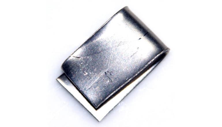 folded sheet of nickel (silver metal) on white