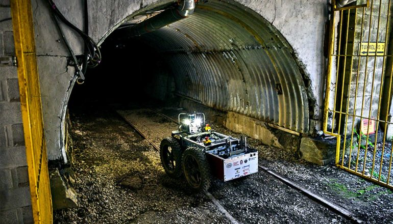 The image shows the robot entering a mine in Pennsylvania. (Subterranean Challenge concept)