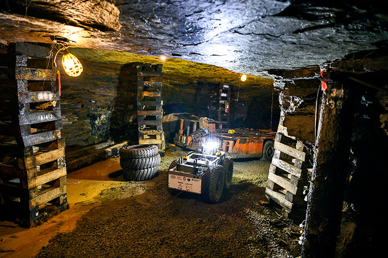 The image shows the underground rescue robot making its way through the test mine. (Credit: Carnegie Mellon)