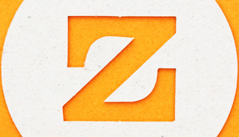 letter z cut-out of cardboard on orange - zinc as key to gonorrhea