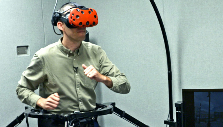 Huffman runs on the treadmill while wearing a virtual reality headset