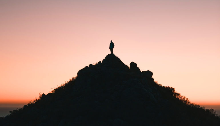 person on mountain in silhouette