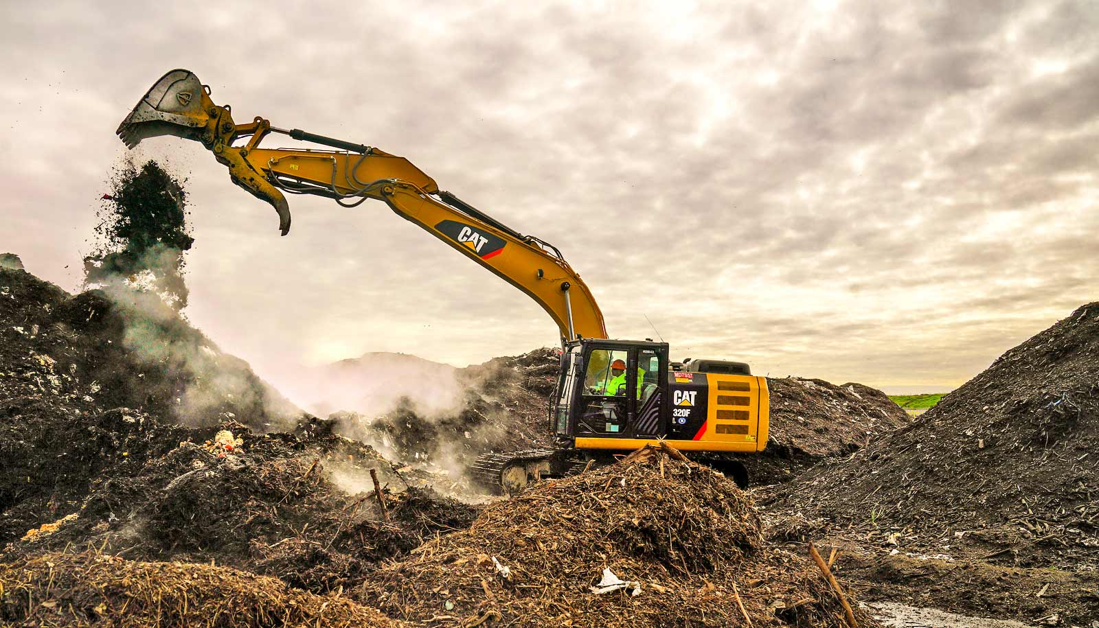 food waste falls from bucket of excavator