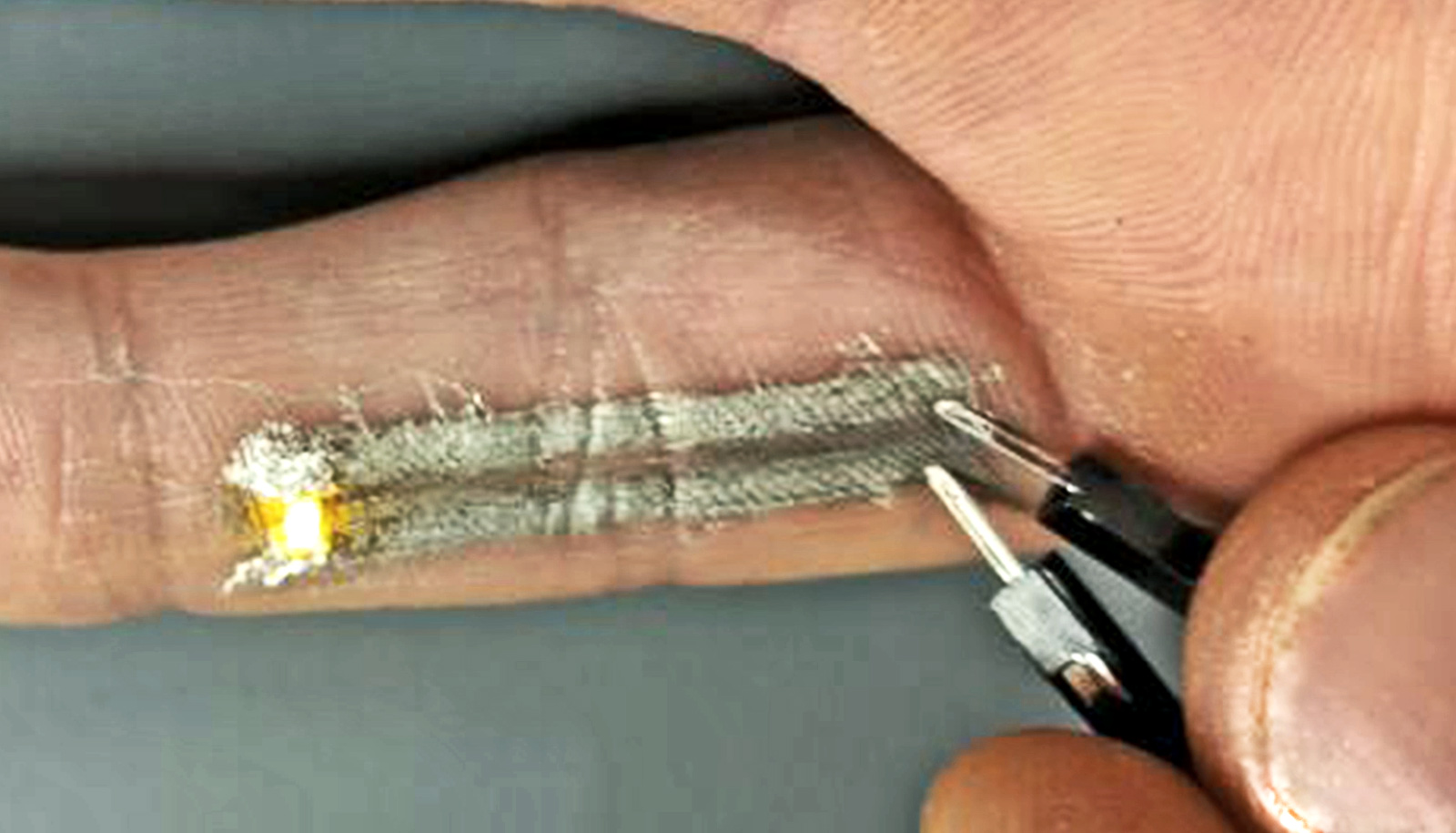 Light-up tattoos use electronics printed right onto skin