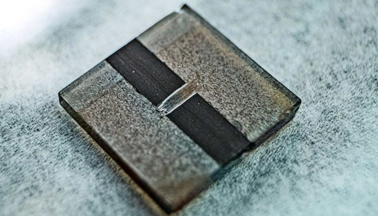 The perovskite solar cell is a small metal-looking square with a dark stripe down its center