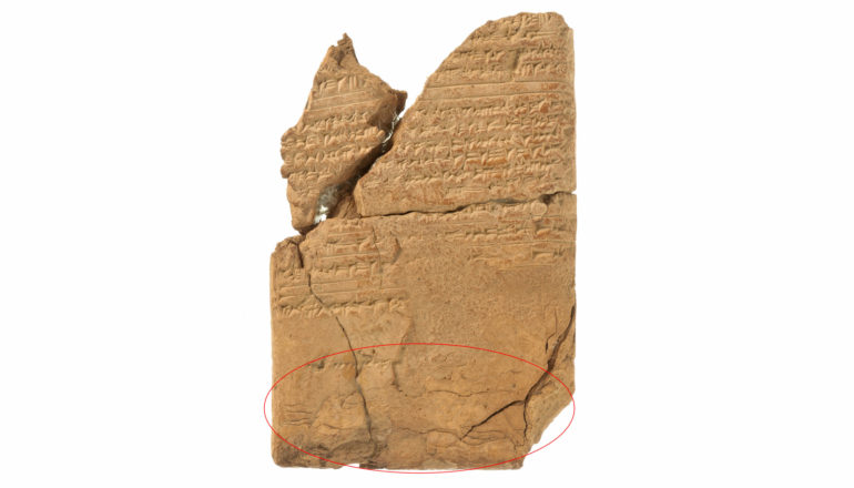 """broken tablet with cuneiform and red circle around """"demon"""" at bottom"""