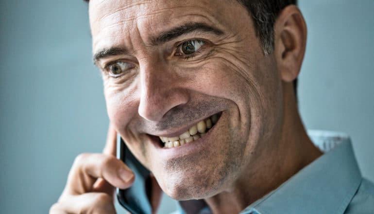 stressed man talks into phone