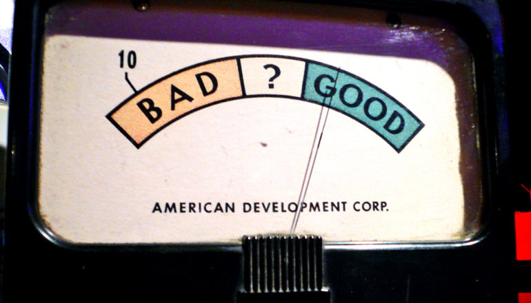 A old machine has a meter that flips between good (highlighted in green) and bad (highlighted in red)