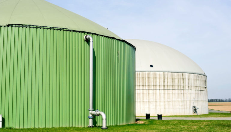 green and white anaerobic digesters