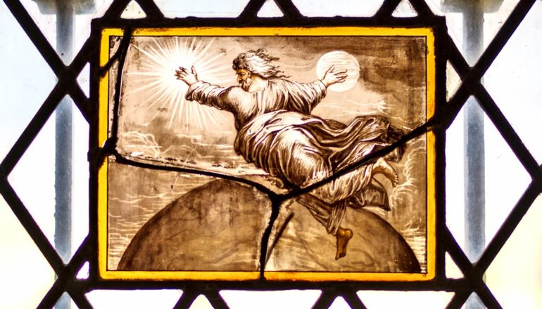 image on glass of God as floating older white man in robes