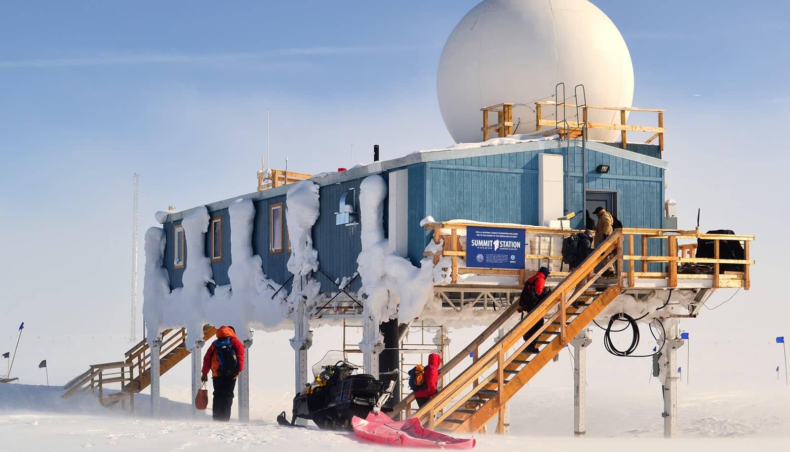 prefab building on stilts in frozen landscape