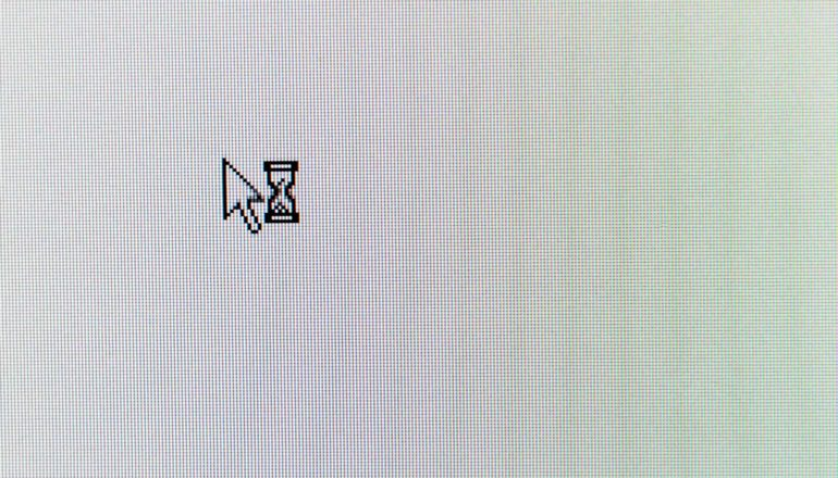cursor arrow and hourglass on blank computer screen