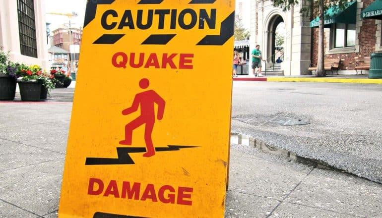 """A sign reads """"Caution: Quake Damage"""""""
