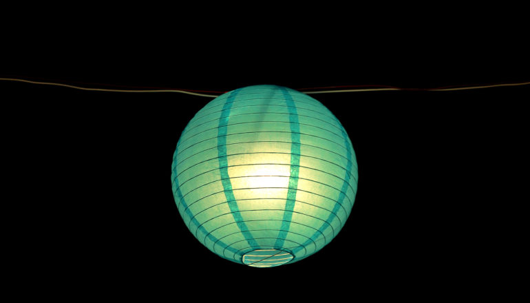 glowing green paper lamp on wire