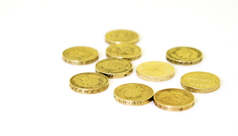 1-pound coins on white