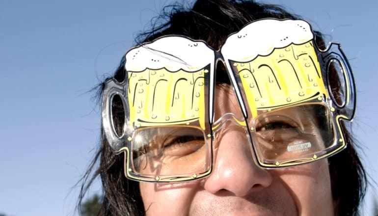 person wearing glasses that look like steins of beer