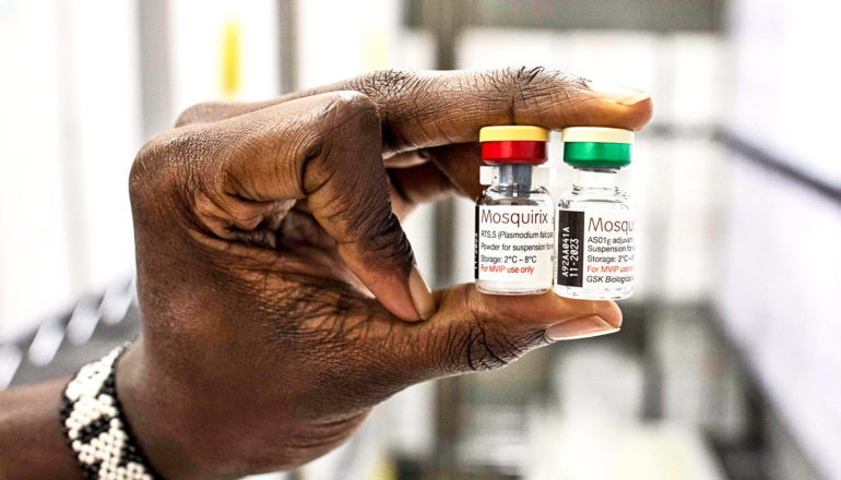 A person holds two vials of the new malaria vaccine